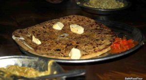 Parantha with butter and achar. Indian street food